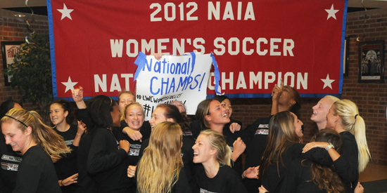 Women's soccer celebrates its national title after returning to campus on Sunday.
